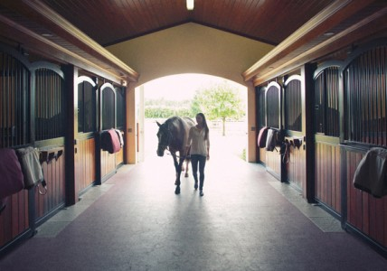 Geargina Bloomberg entering her stables after a day of competing at the Winter Equestrian Festival