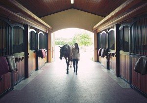 Bloomberg entering her horse stable in Wellington FL after a day of competing in the nearby Winter Equestrian Festival